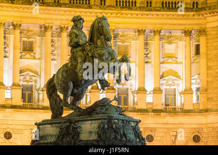 Equestrian sculpture Prinz Eugen in front of Neue Burg, Hofburg Imperial Palace by night, Vienna, Austria - Stock Photo