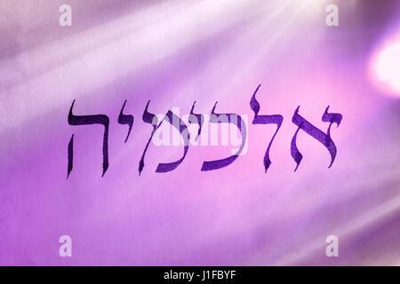 Handwritten word alchemy in hebrew script under colored lights. Hebrew language. - Stock Photo