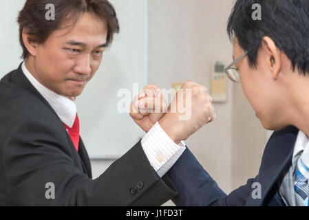 Two Businessman Competing In Arm Wrestling, Competition concept - Stock Photo