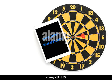 business solution words on tablet screen with dart target on bullseye over white background with copy space, Goal - Stock Photo