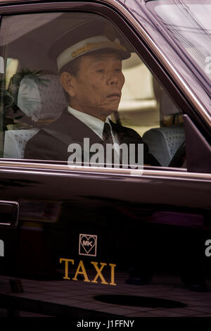 KYOTO, JAPAN - OCTOBER 8, 2016: Unidentified taxi driver in Kyoto, Japan. Japan has an estimated 260,000 taxis operating - Stock Photo