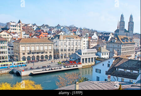 The scenic cityscape of Zurich from the Lindenhof hill, overlooking Limmat river and quay, historic mansions, museums - Stock Photo