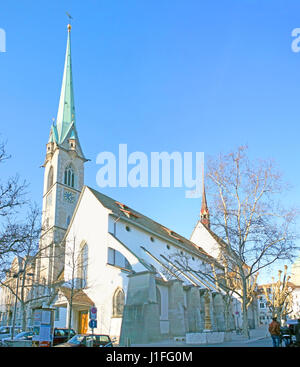 ZURICH, SWITZERLAND - MARCH 20, 2011: The tall spire of Predigerkirche, also serving as the concert hall , on March - Stock Photo