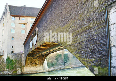 The old bridge of Baden covered with the wooden roof tiles, it connects the Landvogteischloss Castle with old town, - Stock Photo