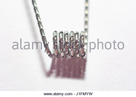 e cigarette coil on isolated white background composition photograph - Stock Photo