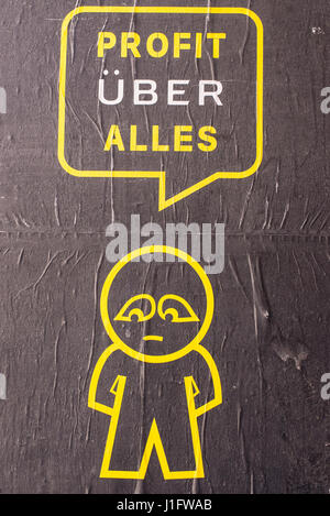 Street art poster from SUBDUDE with stick man and cartoon saying ' Profit Uber Alles'. It refers to the controversial - Stock Photo