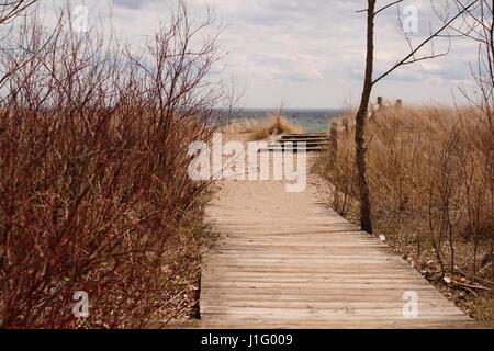 A pathway on the beach leading to Lake Ontario. - Stock Photo