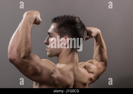 man bodybuilder back side view strong muscular, close up. arms, back ...