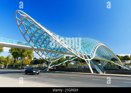 Tbilisi, Georgia - September 27, 2016: Bridge of Peace over the Kura River - Stock Photo