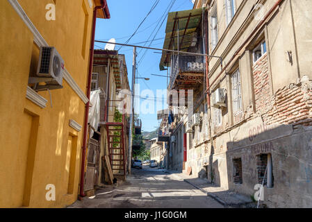Tbilisi, Georgia - September 27, 2016: View of narrow street in Old city - Stock Photo