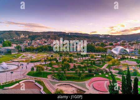 View of Rike Park with Bridge of Peace and Old city at sunset. Center of Tbilisi city, Georgia - Stock Photo