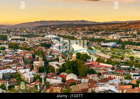 View on Tbilisi city from Sololaki hill on sunset. Georgia - Stock Photo