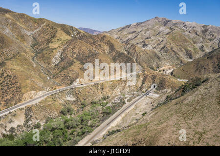 Mountain road and train tracks through the foothills of the San Gabriel mountains in Los Angeles county. - Stock Photo