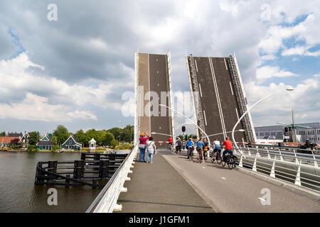 ZAANDAM, NETHERLANDS - JULY 4, 2016 : View of open stone bridge on cloudy sky. Zaanse Schans is popular with windmills. - Stock Photo