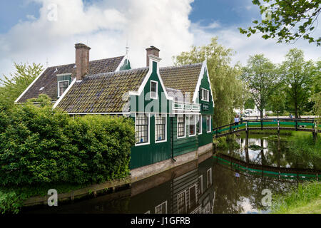ZAANDAM, NETHERLANDS - JULY 4, 2016 : View of traditional small village houses in farm on cloudy sky. Zaanse Schans - Stock Photo