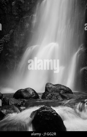 Black and white silky smooth waterfalls Tretes in Indonesia. Long Exposure photography creates surreal dreamy flowing - Stock Photo