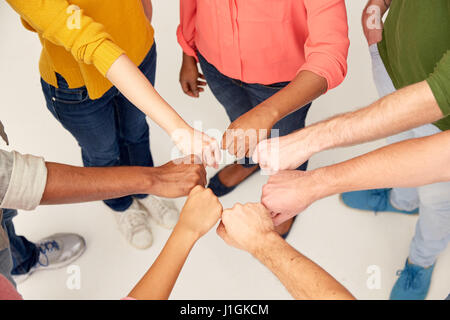 hands of international people making fist bump - Stock Photo