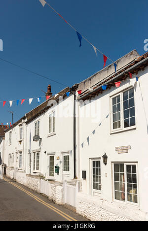 Whitewashed terraced cottages in a street in the coastal town of Sheringham Norfolk UK - Stock Photo