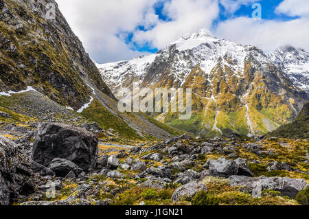 Snowy mountains in the Milford Road, one of the most beautiful scenic roads in New Zealand - Stock Photo