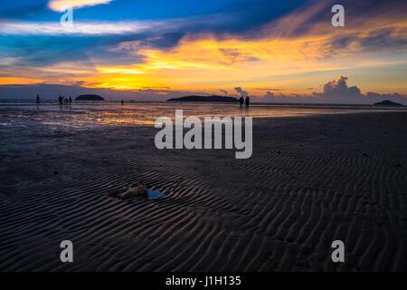 Twilight hour at Tanjung Aru beach in Sabah, Malaysian Borneo. - Stock Photo