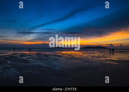 Twilight hour at Tanjung Aru beach in Sabah, Malaysian Borneo. - Stock Photo