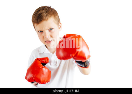 Little boy stand at ring white background with gloves - Stock Photo