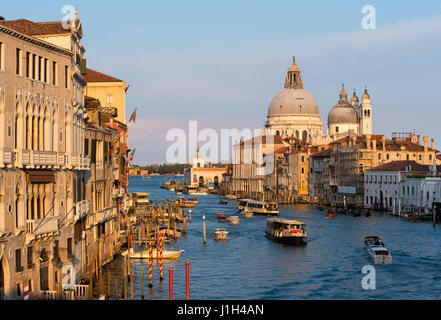 Venice Grand Canal in evening sunshine taken from Ponte dell'Accademia bridge - Stock Photo