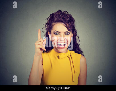 Attractive woman pointing finger up has an idea - Stock Photo