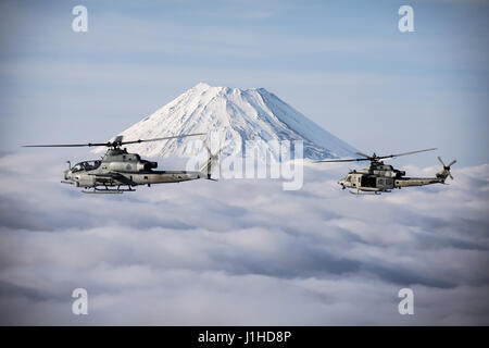 Two Marine Corps helicopters, an AH-1Z Viper and UH-1Y Venom, fly past Mount Fuji, Shizuoka, Japan, - Stock Photo