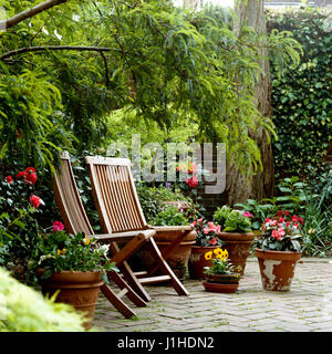 Deck chairs on patio. - Stock Photo