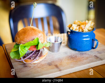 A classic burger and fries (hamburger and French fries) from Ayden Kitchen and Bar in Saskatoon, Saskatchewan, Canada. - Stock Photo