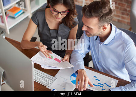 High angle view on working couple - Stock Photo
