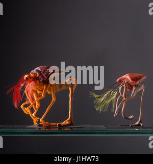 The figurines of two mutant creatures. - Stock Photo
