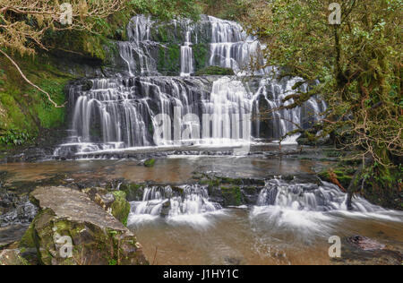 The majestic Purakaunui Falls in The Catlins, the Southern Scenic Route in New Zealand - Stock Photo