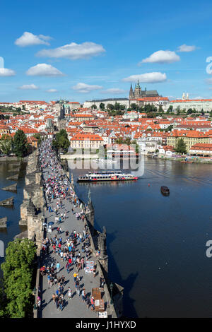 Prague. The Charles Bridge over the Vltava river looking towards Prague Castle and the spires of St Vitus Cathedral, - Stock Photo