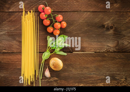 Basic pasta ingredients, spaghetti and vegetables - Stock Photo
