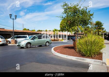 A minivan passes through the parking lot at the Town and Country Shopping Center in the Silicon Valley town of Palo - Stock Photo
