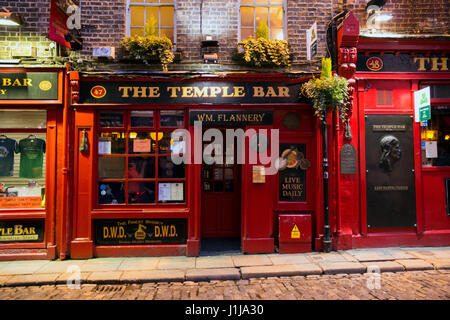DUBLIN, IRELAND - FEB 15, 2014: Night view of the Temple Bar pub in Dublin. Temple Bar historic district is known - Stock Photo