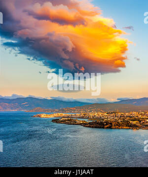 Sunset over the island of Crete, the Bay of Mirabella and Agios Nikolaos, Crete, Greece. - Stock Photo
