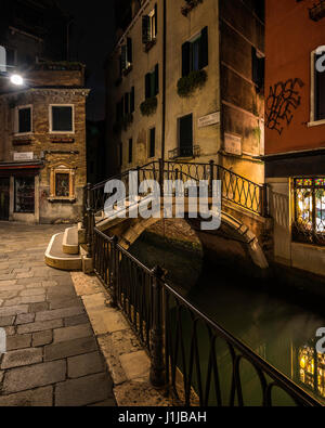 Long Exposure at night of a Venetian canal with a bridge and buildings, Venice, Italy - Stock Photo