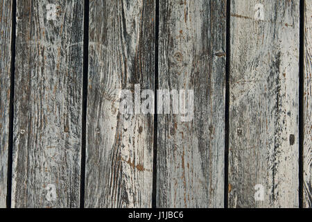 Vertical old cracked wooden plates with horizontal gaps, planks and chinks - Stock Photo