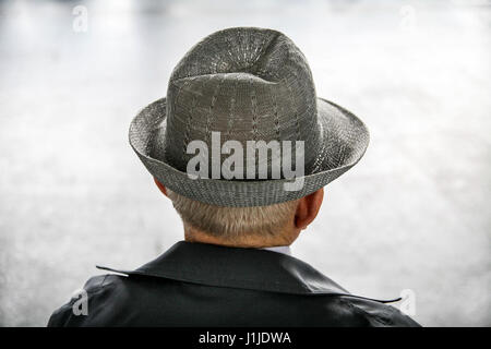 Man in a grey hat - Stock Photo