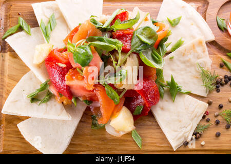 grilled vegetables with chips on wooden background. - Stock Photo