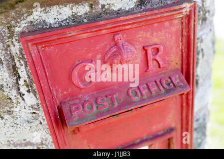 old red GR post box in England - Stock Photo