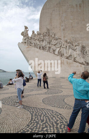 People taking photographs of the Monument to the Discoveries in Lisbon, Portugal. - Stock Photo