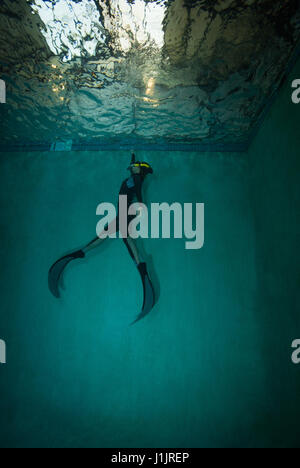 Young woman in a free diving class - Stock Photo