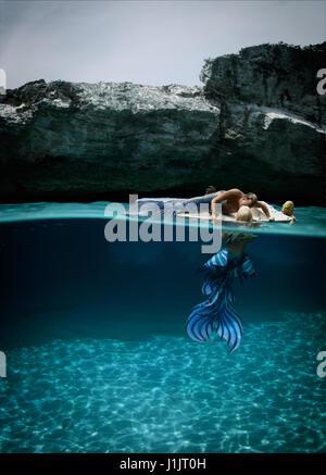 Merman and mermaid with sea monster - Stock Photo