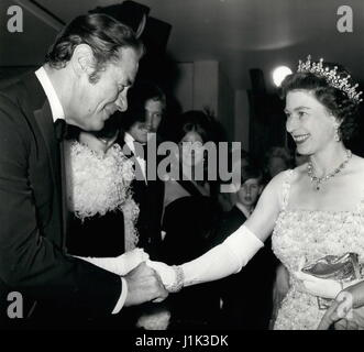 File Photo. 21st Apr, 2017. Britain's QUEEN ELIZABETH, the world's oldest and longest-reigning monarch, celebrates her 91st birthday. Pictured: Dec. 12, 1967 - The Queen meets the stars. : Queen Elizabeth II is introduced it actor Rex Harrison, star of the film ''Doctor Dolittle'' when she attended the premiere showing of the film at the Odeon Cinema, London, last night. The all-ticket showing was in aid of the British Empire Cancer Campaign Charity. (Credit Image: © Keystone Press Agency/Keystone USA via ZUMAPRESS.com) Stock Photo