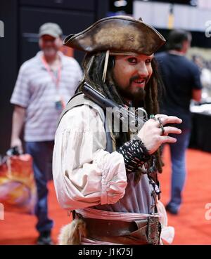 Chicago, USA. 21st Apr, 2017. A cosplayer dressed in Captain Jack Sparrow's costume poses for pictures during the - Stock Photo