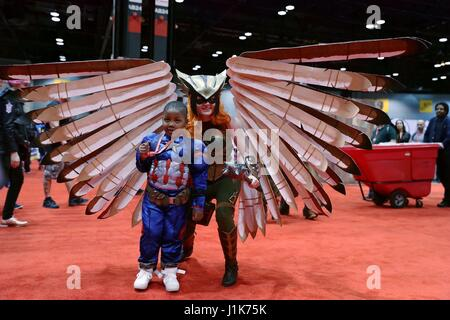 Chicago, USA. 21st Apr, 2017. A female cosplayer dressed in costume and a boy in Captain America's costume pose - Stock Photo